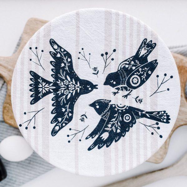 couvre-bol dimension 25cm avec un motif de 3 oiseaux